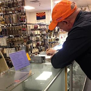 Mark Kelly in a Tuscon, Ariz., gun store (Captain Mark Kelly/Facebook)